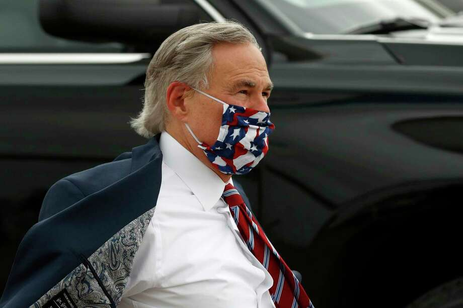 Texas Gov. Greg Abbott arrives to greet Vice President Mike Pence at Love Field in Dallas, Sunday, June 28, 2020. (AP Photo/Tony Gutierrez) Photo: Tony Gutierrez, STF / Associated Press / Copyright 2020 The Associated Press. All rights reserved.