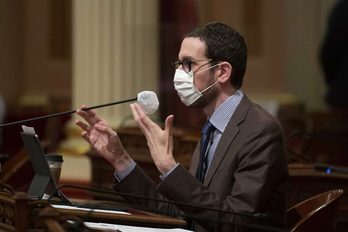 State Sen. Scott Wiener, D-San Francisco, questions Corrections Secretary Ralph Diaz, about the coronavirus outbreak at San Quentin State Prison during a Senate oversight hearing in Sacramento, Calif., Wednesday, July 1, 2020. Lawmakers criticized state corrections officials for inadvertently transferring infected inmates from a Southern California prison to San Quentin, near San Francisco, triggering the state's worst prison coronavirus outbreak. (AP Photo/Rich Pedroncelli)