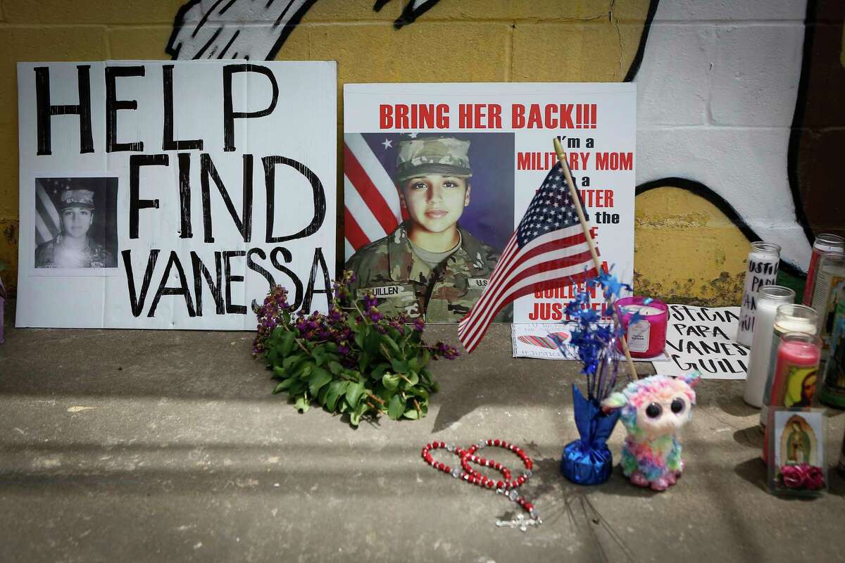 """People have left notes, stuffed animals, flags, flowers candles and notes for Vanessa Guillen at a mural painted by Alejandro """"Donkeeboy"""" Roman Jr. on the side of Taqueria Del Sol, 8114 Park Pl. Blvd. Thursday, July 2, 2020, in Houston."""