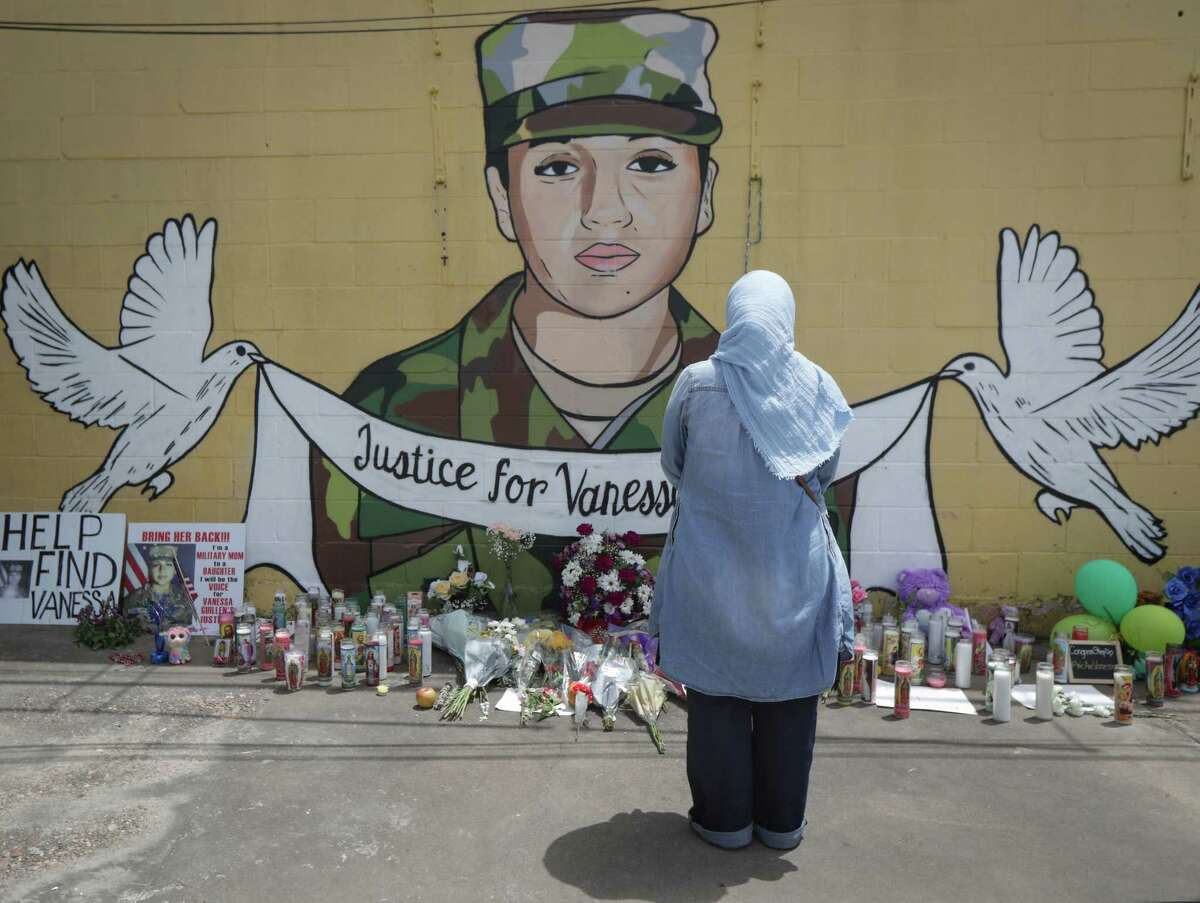"""Marleny Vargas pays her respects to Vanessa Guillen at the site of a mural painted by Alejandro """"Donkeeboy"""" Roman Jr. on the side of Taqueria Del Sol, 8114 Park Pl. Blvd. Thursday, July 2, 2020, in Houston."""
