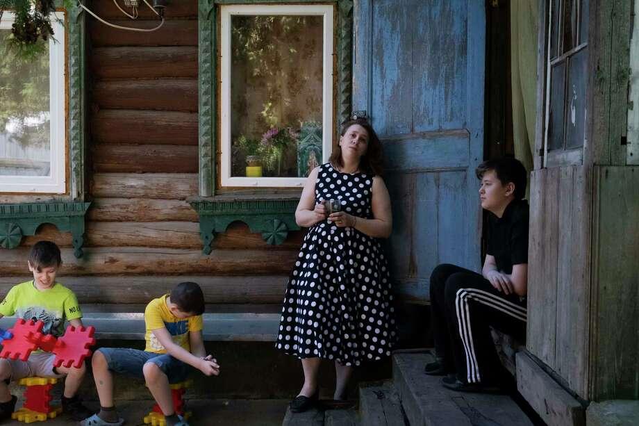 Yekaterina Gorbunova and three of her four children hang out near her mother-in-law's house outside Moscow on June 24, 2020. Photo: Photo For The Washington Post By Oksana Yushko / Oksana Yushko