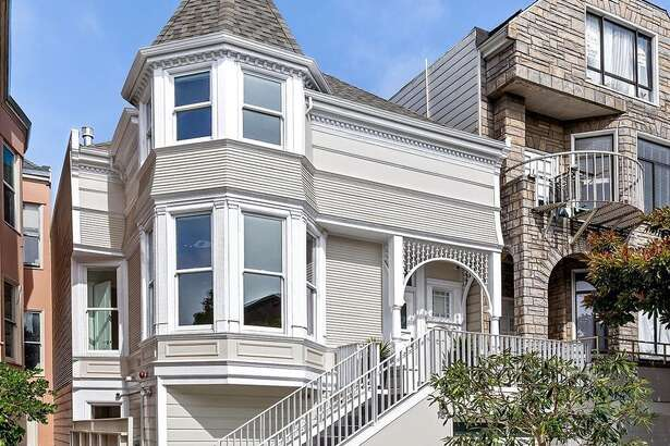 """The home's Victorian facade has been maintained over the years, though a two-car garage and the front staircase was likely added in the 1940s. """"With a gabled roof and turret the home will catch the eye of even the most casual passerby,"""" said Kearney."""