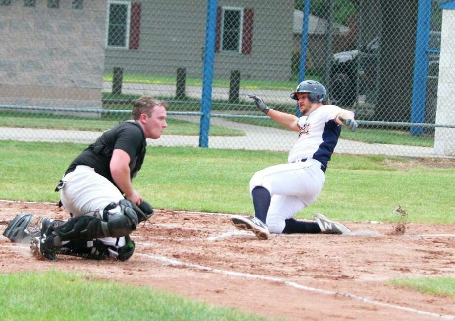 Manistee right fielder Lucas Richardson slides into home against Michigan Sports Academy on June 20. (News Advocate file photo)