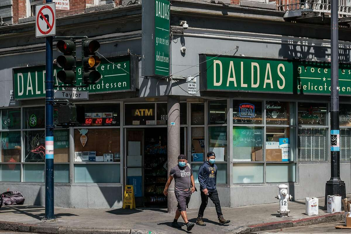 People are seen near Daldas Grocery and Delicatessen on the corner of Taylor and Eddy which, had until yesterday, been the site of a large tent encampment in San Francisco on Tuesday, July 2, 2020. Those folks have since been moved to temporary housing.