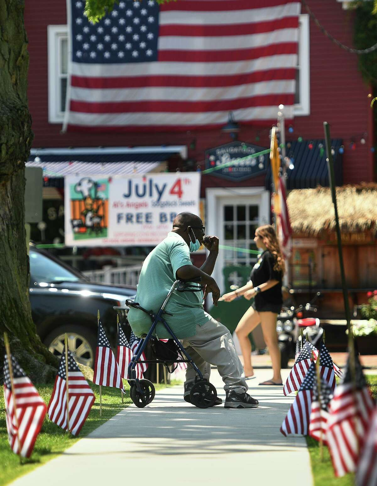 After flag banners were removed, American flags now line the sidewalks on Sherman Green in preparation for Independence Day in Fairfield, Conn. on Thursday, July 2, 2020.