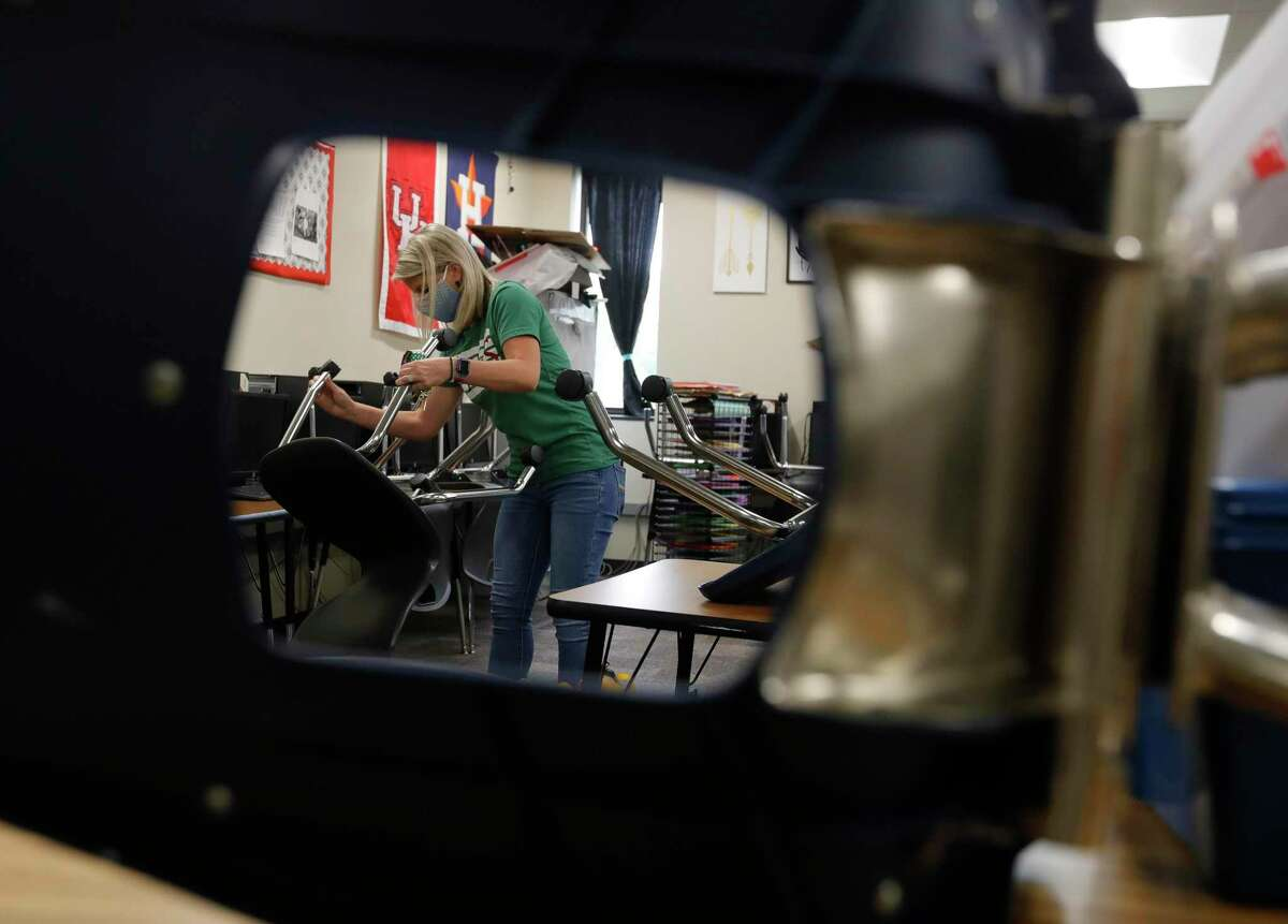 Kendra Meyers, a business and marketing teacher, straightens up her room before locking up for the summer at The Woodlands High School, Tuesday, May 12, 2020, in The Woodlands. When Governor Greg Abbott closed schools, all instruction moved online. It is still unclear what next school year will look like but will likely include an online option from most schools.