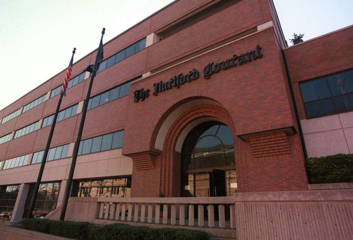The Hartford Courant building on Broad Street in Hartford, Conn., Monday, March 13, 2000. The Courant is a subsidiary of the Times Mirror Corporation, which has been bought by the Tribune company based in Chicago. (AP Photo/The Hartford Courant, Alan Chaniewski)