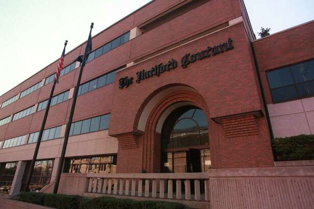 A file photo of the Broad Street offices of the Hartford Courant in Hartford, Conn. (AP Photo/The Hartford Courant, Alan Chaniewski)