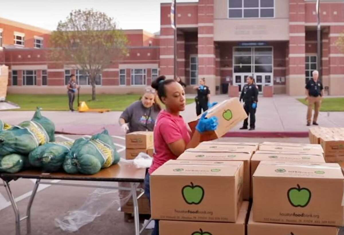 Volunteers from Fort Bend ISD and the Houston Food Bank organize donations at a food distribution site last April atat Missouri City Middle School, which Fort Bend also used for its Grab and Go Meal distributions for most of the summer.