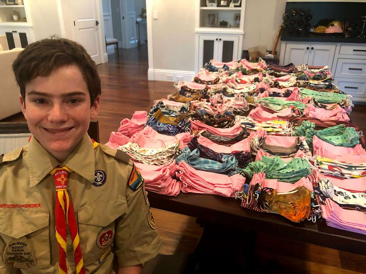 Menlo Park Boy Scout Parker Brown, 14, and some of the 1,280 masks he and his friends sewed for a Palo Alto hospital.
