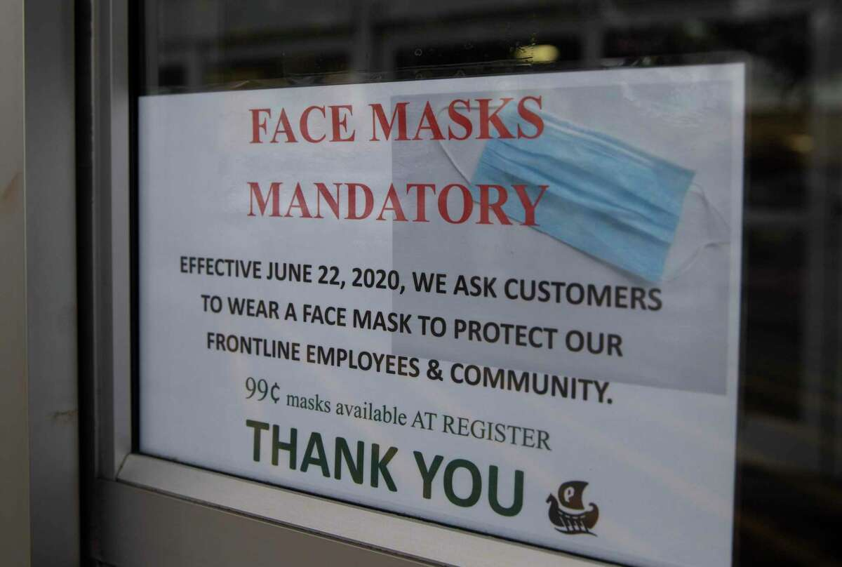 People shop at Phoenicia Specialty Foods are required to wear face masks Monday, June 22, 2020, in Houston. Seattle software company RealNetworks has developed an app and data platform that aims to promote mask use and address the safety concerns of businesses, governments and other organizations.
