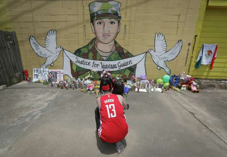 """Dawn Gomez hugs her 3-year-old granddaughter, Saryia Greer as she paid her respects to Vanessa Guillen at a mural painted by Alejandro """"Donkeeboy"""" Roman Jr. on the side of Taqueria Del Sol, 8114 Park Pl. Blvd. Thursday, July 2, 2020, in Houston."""