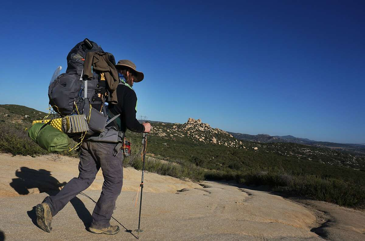 Backpacker Stan Nassano heads out onto the Pacific Crest Trail at the Southern Terminus along the U.S.- Mexico Border in Campo, CA on Friday April 17, 2015. Following the release of the movie Wild last year based on the best-selling book and featuring Reese Witherspoon as a novice hiker tackling the trail, known colloquially as the PCT the Pacifict Crest Trail Association has struggled to match demand for time on the trail. (Photo by Sandy Huffaker/Corbis via Getty Images)