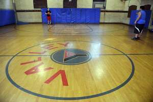 Two teens play basketball in 2014 at The Valley YMCA in Ansonia.