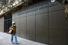 A man walks by the Employment Development Department office on Monday, June 15, 2020 in San Francisco, California.