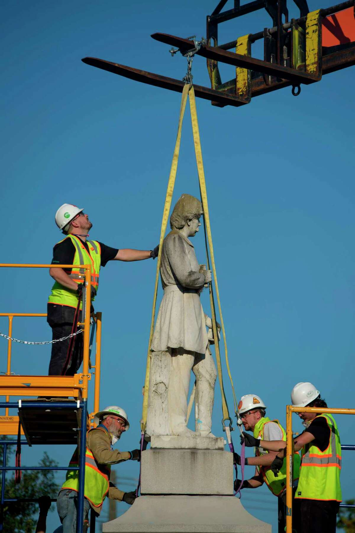 Houston city workers removed a statue of Dick Dowling from Hermann Park on June 17. Frank Teach mass-manufactured largely the same statue - a generic Confederate soldier in a hat, at ease, with a rifle. - that can be found in cities across Texas.