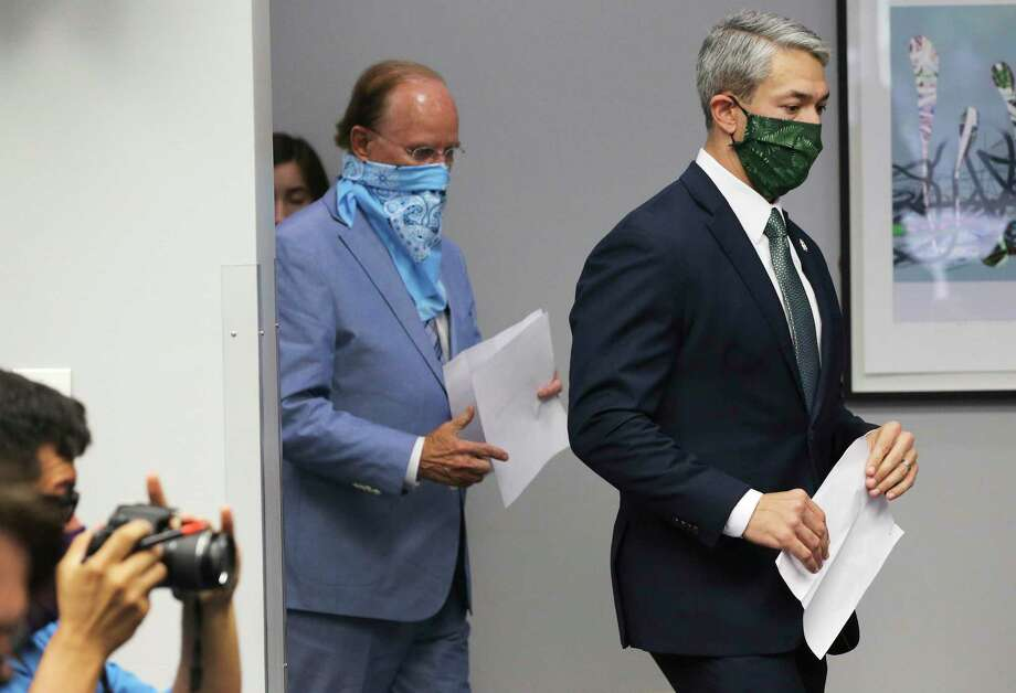 San Antonio Mayor Ron Nirenberg (right) and Bexar County Judge Nelson Wolff are continuing to strongly encourage the public to wear masks to protect themselves from COVID-19. The virus is continuing to push hospital systems to the limit in the local area and across Texas. Photo: Kin Man Hui /Staff Photographer / **MANDATORY CREDIT FOR PHOTOGRAPHER AND SAN ANTONIO EXPRESS-NEWS/NO SALES/MAGS OUT/ TV OUT