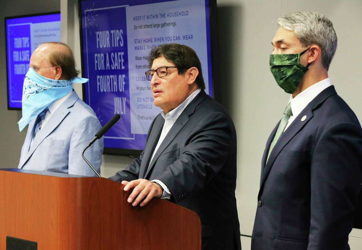 George Hernandez, president and CEO of University Health System (center) speaks as Mayor Ron Nirenberg (right) and Bexar County Judge Nelson Wolff (left) join the leaders of the county's four hospital systems as they give a press conference on the stress levels local hospitals are undergoing as a result of the surge of COVID-19 cases and hospitalizations.