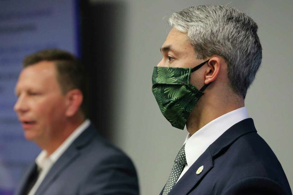 Nirenberg wears a mask as Matt Stone, CEO of Baptist Health System, speaks about the crisis.