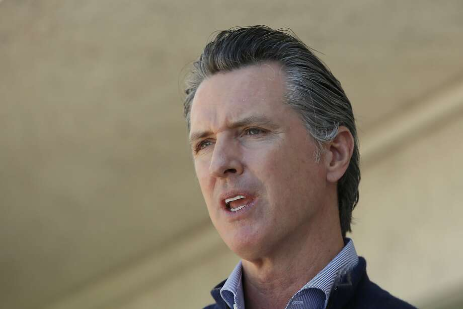 California Gov. Gavin Newsom gives an update on the state's initiative to provide housing for homeless Californians to help stem the coronavirus, during a visit to a Motel 6 participating in the program in Pittsburg, Calif., Tuesday, June 30, 2020. Photo: Rich Pedroncelli / Associated Press