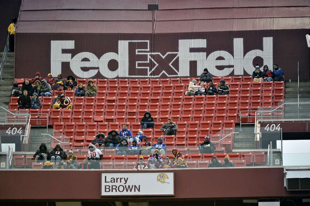 """FILE - In this Dec. 9, 2018, file photo, FedEx Field is less than full during the second half of an NFL football game between the Washington Redskins and the New York Giants in Landover, Md. The title sponsor of the Redskins' stadium wants them to change their name. FedEx said in a statement Thursday, July 2, 2020, """"We have communicated to the team in Washington our request that they change the team name."""" (AP Photo/Mark Tenally, File)"""