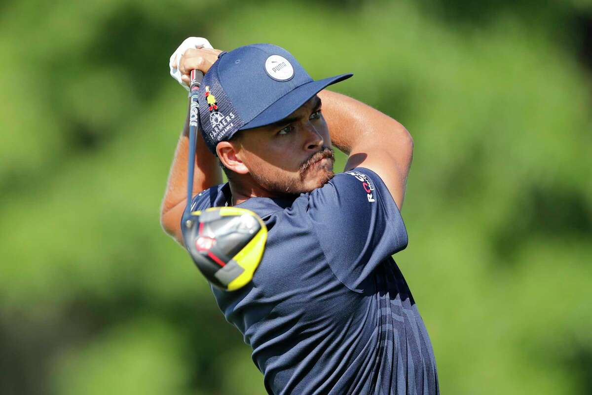 Rickie Fowler hits from the 18th tee during the first round of the Rocket Mortgage Classic golf tournament, Thursday, July 2, 2020, at the Detroit Golf Club in Detroit. (AP Photo/Carlos Osorio)