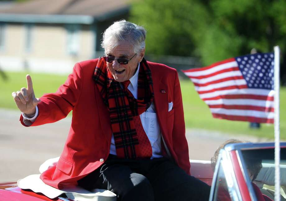 Bud Leonard, grand marshall, waves to spectators during Saturday morning's homecoming parade. Lamar University students, facility, alumni and athletes participated in the school's first homecoming parade in several decades on Saturday morning. The parade was part of Saturday's festivities leading up to the game against Houston Baptist. Photo taken Saturday 11/1/14 Jake Daniels/@JakeD_in_SETX Photo: Jake Daniels / ©2014 The Beaumont Enterprise/Jake Daniels