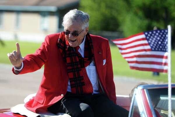 Bud Leonard, grand marshall, waves to spectators during Saturday morning's homecoming parade. Lamar University students, facility, alumni and athletes participated in the school's first homecoming parade in several decades on Saturday morning. The parade was part of Saturday's festivities leading up to the game against Houston Baptist. Photo taken Saturday 11/1/14 Jake Daniels/@JakeD_in_SETX