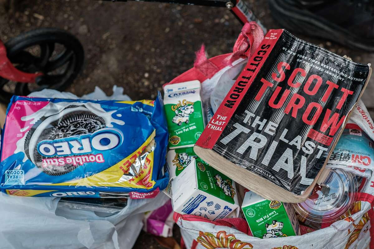"""A close up of the bag that John """"Eric"""" Pradd has with him as he reads near the corner of Turk and Van Ness in San Francisco on Friday, June 26, 2020. Mr. Pradd has had the same routine for years, he will sit between Books Inc. and Peete's Coffee, up against the same tree and read all day long making sure to greet each passerby with a friendly, """"Good afternoon."""""""
