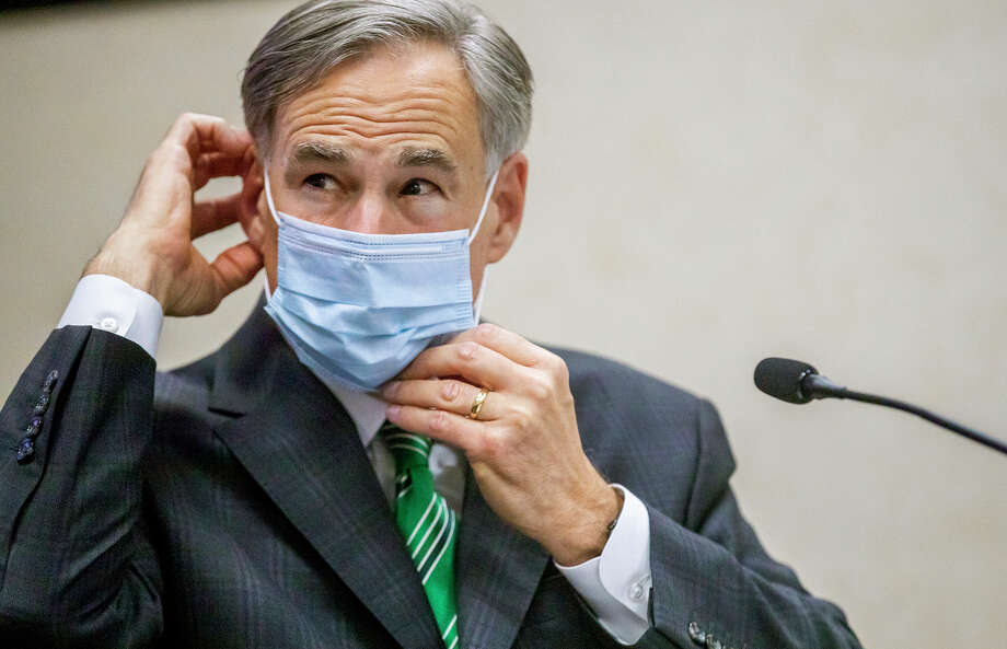 FILE - In this June 16, 2020, file photo, Texas Gov. Greg Abbott adjusts his mask after speaking in Austin, Texas.  Abbott on Thursday, July 2, ordered that face coverings must be worn in public across most of the state, a dramatic ramp up of the Republican's efforts to control spiking numbers of confirmed coronavirus cases and hospitalizations. (Ricardo B. Brazziell/Austin American-Statesman via AP, File) Photo: Ricardo B. Brazziell / AUSTIN AMERICAN-STATESMAN