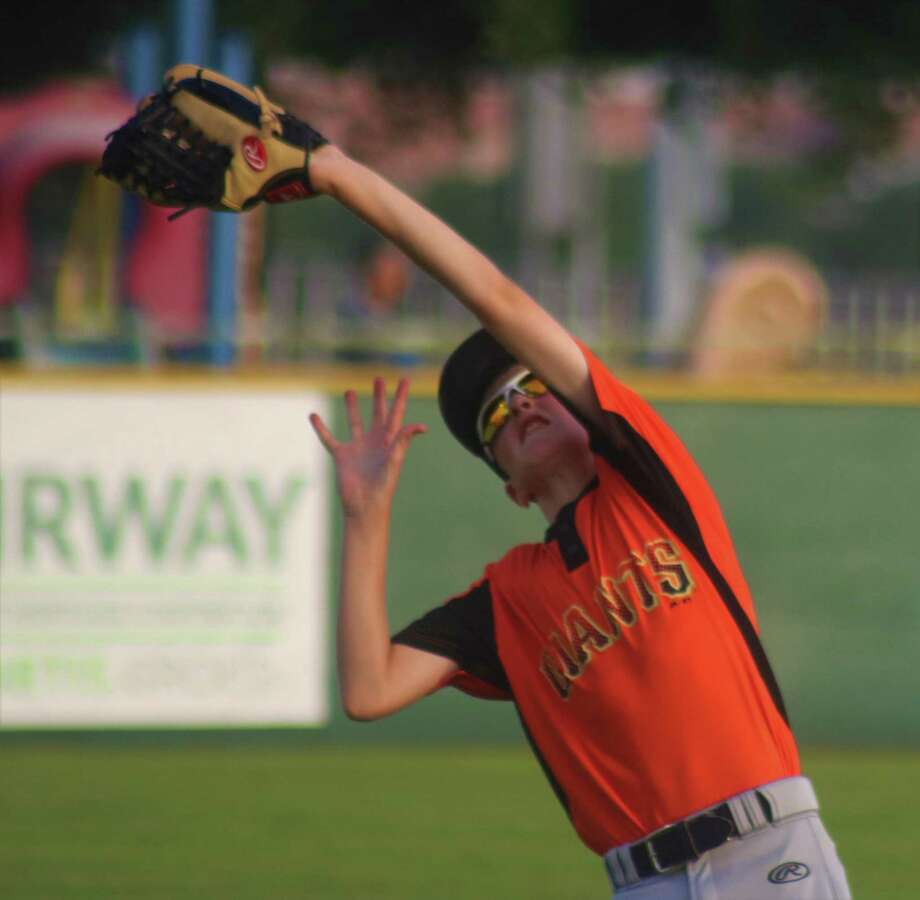 Giants left fielder Luke Upp makes a nice catch near the foul line for the first out of the seventh inning Thursday night. Unfortunately for Giants fans, it would be the last out they recorded. Photo: Robert Avery