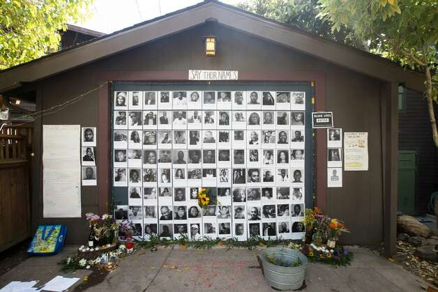 Neeka Salmasi helped create a Black Lives Matters altar honoring the lives of African-Americans killed by police officers on the garage door of a Berkeley Hills home in Berkeley, Calif. on July 2, 2020. Photo: Douglas Zimmerman/SFGATE / SFGATE