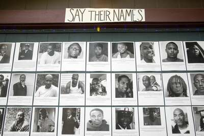 Neeka Salmasi helped create a Black Lives Matters altar honoring the lives of African-Americans killed by police officers on the garage door of a Berkeley Hills home in Berkeley, Calif. on July 2,2020.