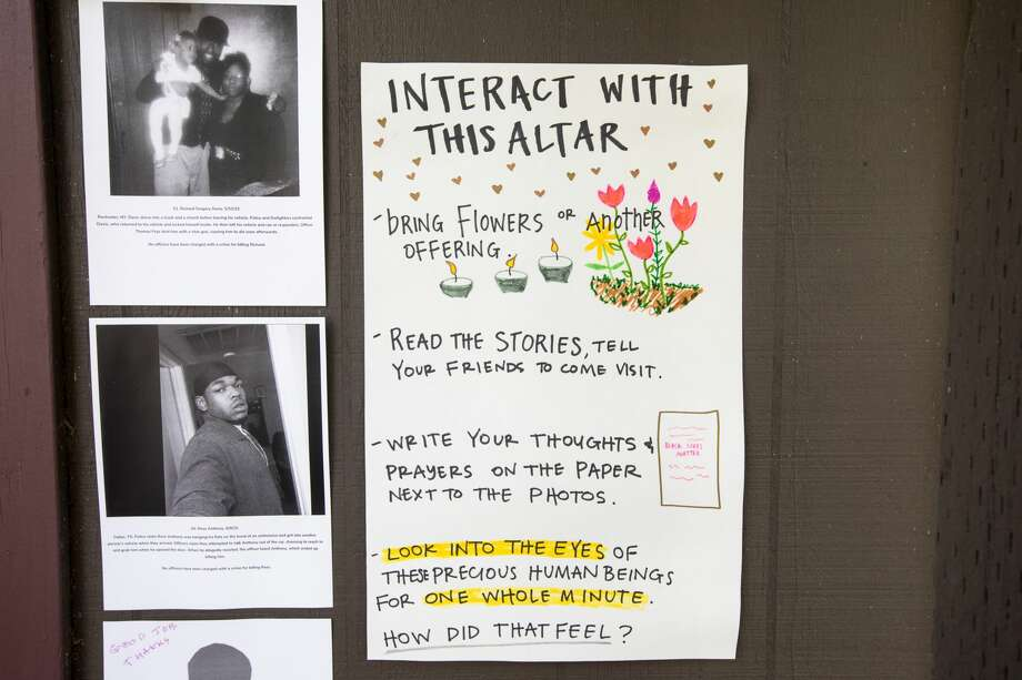 A sign explains with to visitors how to interact with a memorial altar Neeka Salmasi created on the garage door of a Berkeley Hills home in Berkeley, Calif. on July 2, 2020. The Black Lives Matters altar honoring the lives of African-Americans killed by police officers across the United States. Photo: Douglas Zimmerman/SFGATE / SFGATE