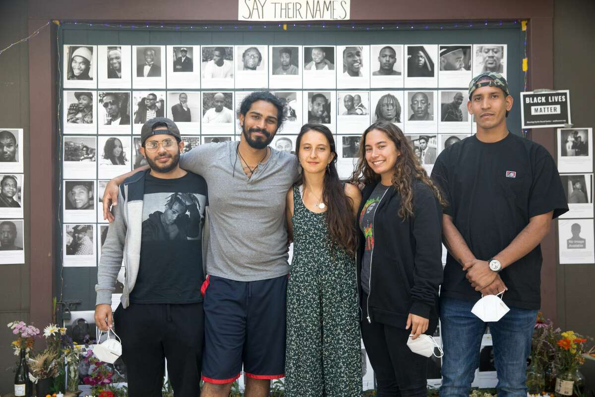 (Left to right) Eduardo Peralta, Michael Anand Manoharan-Valerio, Neeka Salmasi, Valerie Alphin, and Raul Casanova helped create a Black Lives Matters altar honoring the lives of African-Americans killed by police officers on the garage door of a Berkeley Hills home in Berkeley, Calif. on July 2, 2020.