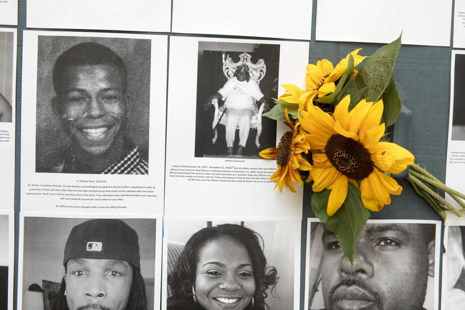 Some of the lives of African-Americans killed by police officers on a memorial altar on the garage door of a Berkeley Hills home in Berkeley, Calif. on July 2,2020. Neeka Salmasi helped create a Black Lives Matters altar on the home's garage door. Photo: Douglas Zimmerman/SFGATE / SFGATE