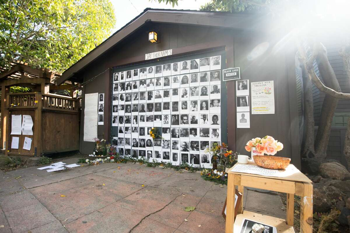 Neeka Salmasi helped create a Black Lives Matters altar honoring the lives of African-Americans killed by police officers on the garage door of a Berkeley Hills home in Berkeley, Calif. on July 2, 2020.