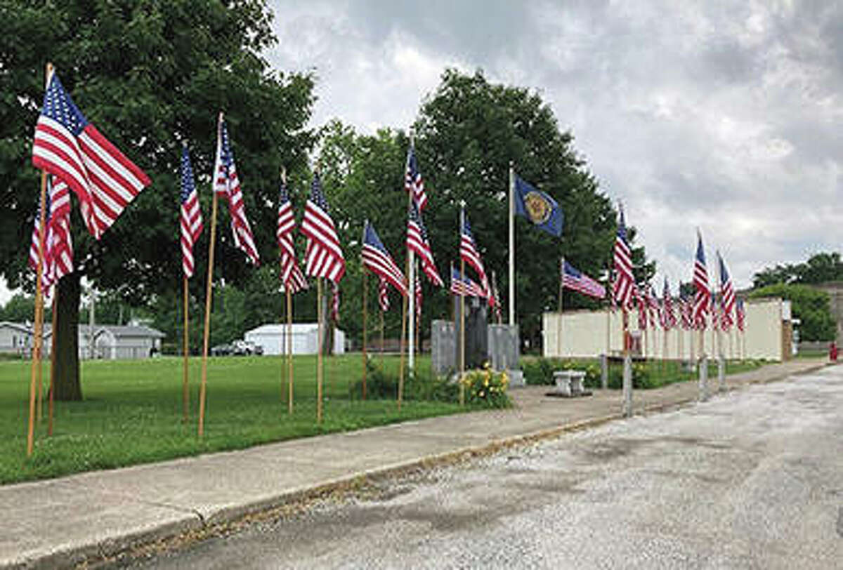 American flags fly in downtown Chapin in celebration of Independence Day.