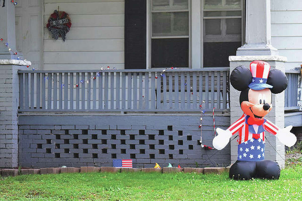 Mickey Mouse welcomes passers-by as part of the red, white and blue decorations at a house in Jacksonville.
