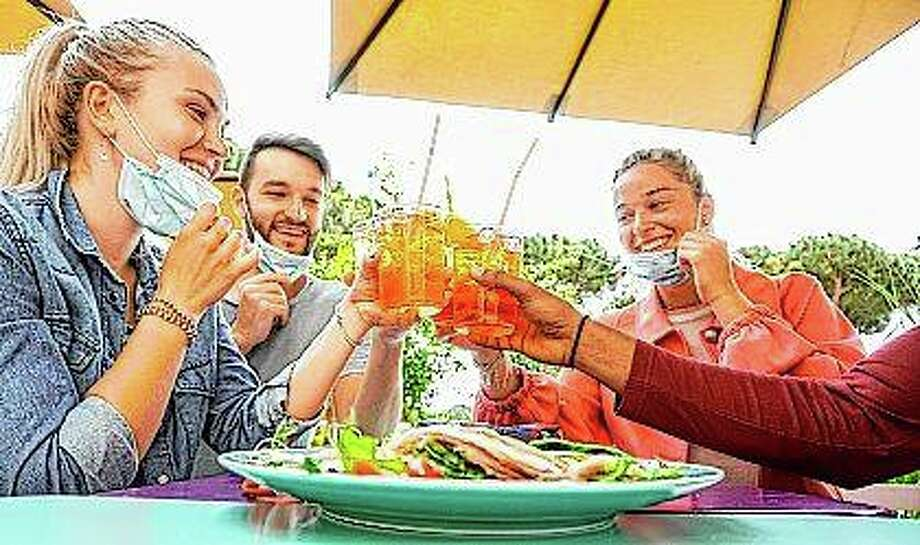 Get-togethers with friends and family are a big part of summer for a lot of people. But getting together this summer — and doing it safely — is going to take effort, planning and a willingness to make some rules and stick to them. Photo: Getty Images