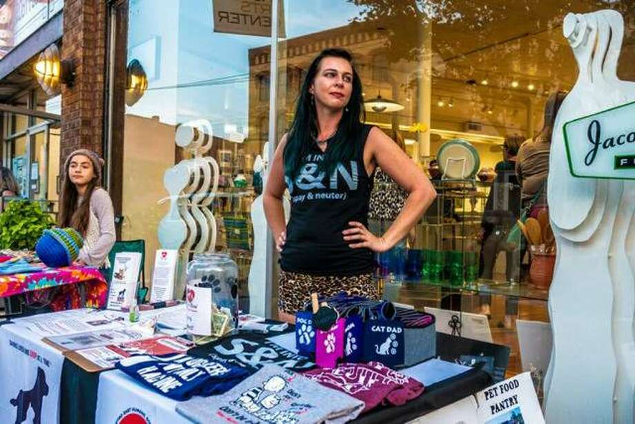 Vendors sell their goods outside of Jacoby Arts Center during the 2018 season of the Thursday Night Market, now in its fifth year. The weekly market, featuring music and various merchandise vendors, is a collaborative partnership between Alton Main Street and Jacoby Arts Center.