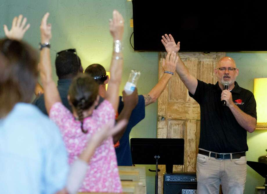 "Luke Redus, co-founder and director of Compassion United, preaches at Conroe House of Prayer, Wednesday, July 17, 2019, in Conroe. The ministry group is in the process of developing five acres of land off Foster Drive donated to them by the city of Conroe. In addition to moving CHOP from its location on West Davis Street to the donated land, the organization hopes to develop a master planned community called ""Miracle City"" to support people transitioning out of homelessness and to provide long-term supportive housing options for those requiring financial, emotional, and community support for an extended period. Photo: Jason Fochtman, Houston Chronicle / Staff Photographer / Houston Chronicle"