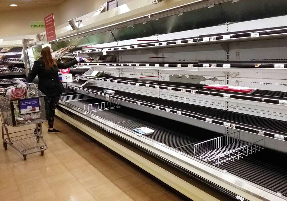 One of the meat isles is empty at Stop & Shop in Milford, Conn., on Saturday Apr. 18, 2020. Due to outbreaks of the coronavirus at several large processing plants, meat product supply around the country is being disrupted. Photo: Christian Abraham / Hearst Connecticut Media / Connecticut Post
