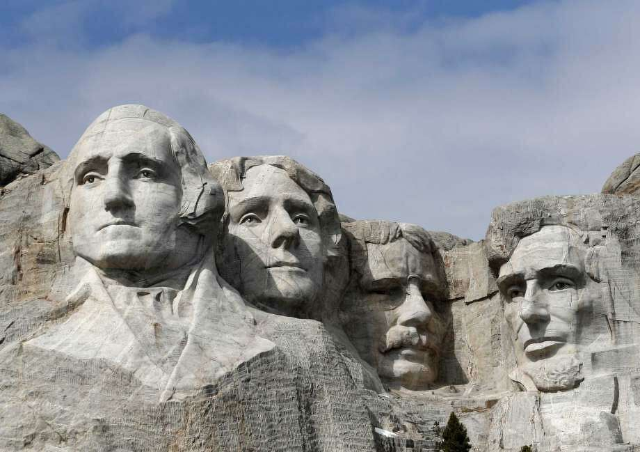 FILE - This March 22, 2019, file photo shows Mount Rushmore in Keystone, S.D. President Donald Trump will begin his Independence Day weekend on Friday with a patriotic display of fireworks at Mount Rushmore National Memorial before a crowd of thousands. Photo: Photo: David Zalubowski, AP