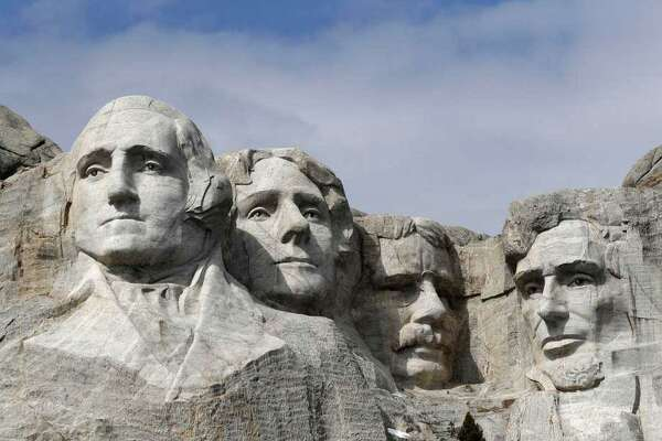 FILE - This March 22, 2019, file photo shows Mount Rushmore in Keystone, S.D. President Donald Trump will begin his Independence Day weekend on Friday with a patriotic display of fireworks at Mount Rushmore National Memorial before a crowd of thousands.