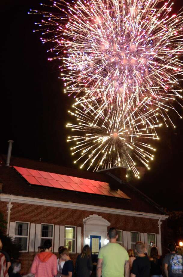 Fireworks light up the sky in downtown Milford last summer, but when the fireworks are over this year the night sky will still have plenty of amazing things to gaze at. Photo: Jill Dion / Hearst Connecticut Media