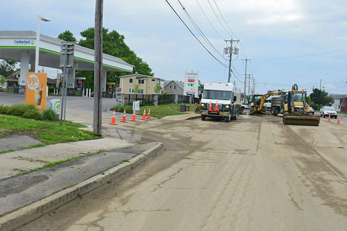 Crews work to fix a water main break on the westbound side of Central Ave. in front of Cumberland Farms near Reynolds St. on Friday, July 3, 2020 in Colonie, N.Y. (Lori Van Buren/Times Union)