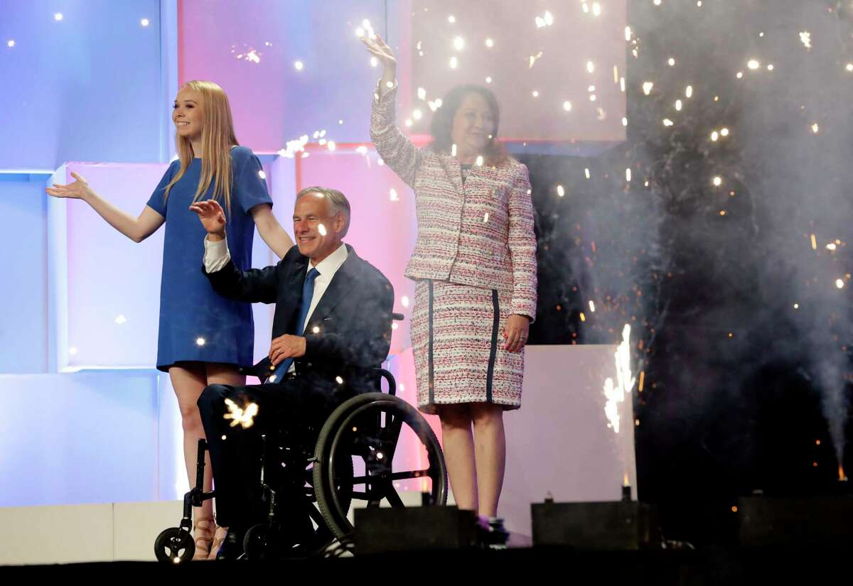 In this June 15, 2018 file photo, Texas Gov. Greg Abbott, center, with wife, Cecilia, right, and daughter, Audrey, at the Texas GOP Convention, in San Antonio. After the Texas GOP executive committee voted to press ahead with plans for an in-person convention in downtown Houston later this month, the Texas Medical Association announced it was withdrawing as a sponsor of the event. (AP Photo/Eric Gay File)