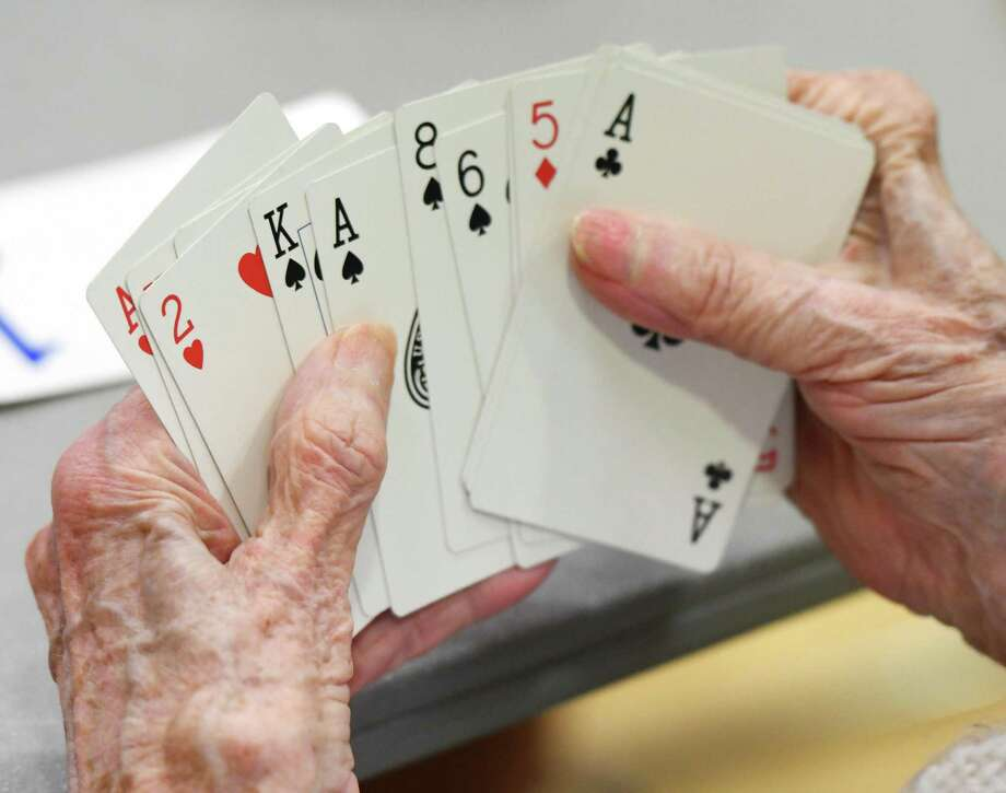 """Greenwich's Dorothea Bellafonte, 101, looks over her hand in the Fairfield County Duplicate Bridge match at the YWCA in Greenwich, Conn. Monday, July 1, 2019. The group meets every Monday for an official match franchised by American Contract Bridge League. Master points awarded throughout the season at players participating in 15 or more games are eligible for YWCA """"Player of the Year"""" awards. The games are open to both members and non-members. In addition, on Fridays there are supervised bridge games in which interesting hands are chosen for a chalkboard explanation and discussion. Photo: File / Tyler Sizemore / Hearst Connecticut Media / Greenwich Time"""