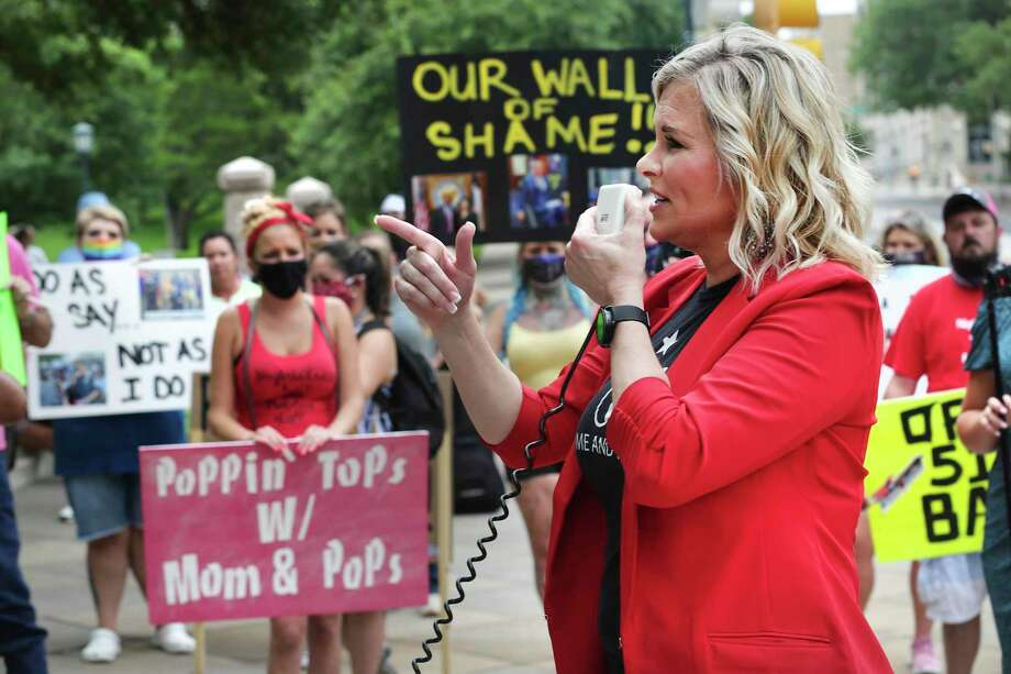 Shelley Luther, who gained fame after being arrested when she kept her Dallas hair salon open and later released by Gov. Greg Abbott, speaks to close to 150 Texas bar owners, bartenders, and members of Texas Bars Fight Back, gathered in front of the Texas State Capital in response to Gov. Abbott's closing bars after the recent spike of COVID-19, on Tuesday, June, 30, 2020. Photo: Bob Owen, Staff-photographer / San Antonio Express-News / ©2020 San Antonio Express-News